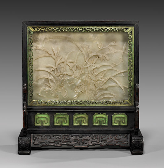 Chinese carved celadon jade tablescreen with flowering bushes and rocks on obverse; lacquered landscape scene on verso. Estimate: $8,000-$12,000.