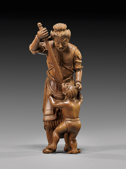 Signed carved-wood sashi netsuke depicting warrior deity with oni at his feet. Ex Michael Earlman Collection. Estimate: $2,500-$3,000. I.M. Chait image.