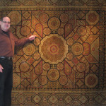 Owner Bob Anderson with Celtic-style carpet from India. Aaron's Oriental Rug Gallery image.