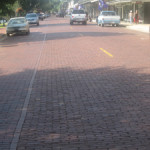 Historic brick street in downtown Natchitoches, La. Image by Billy Hathorn. This file is licensed under the Creative Commons Attribution-Share Alike 3.0 Unported license.