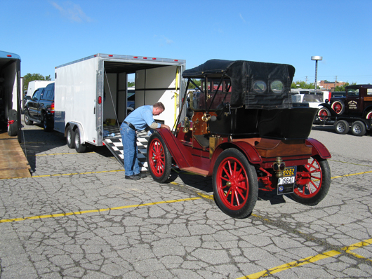 Charlie Reindel readies the 1910 International Harvester Model F Roadster for an antique car show. Submitted photo.