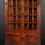 1905 Gustav Stickley oak corner cupboard with original finish and copper strap hardware. Cottone Auctions image.