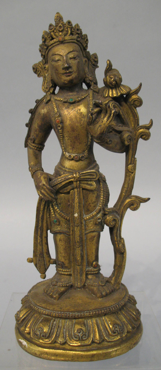 The figure of an Eastern deity that sold for £11,100 ($16,835) at Dee Atkinson & Harrison's East Yorkshire salerooms on Feb. 15. Image courtesy Dee Atkinson & Harrison.