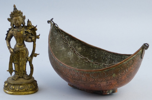 A 'job lot' comprising a copper bowl and a cast brass figure that together confounded a presale estimate of £200-£300 to fetch £11,100 ($16,835) at Dee Atkinson & Harrison's Driffield rooms in East Yorkshire on Feb. 15. It was the deity that did it. Image courtesy Dee Atkinson & Harrison.