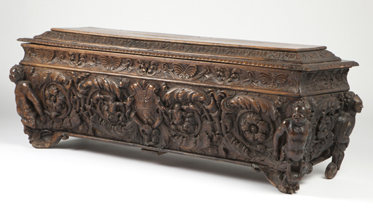 This richly carved 18th century Italian cassone is offered at an estimate of $2,000 to $3,000. John Moran Auctioneers image.