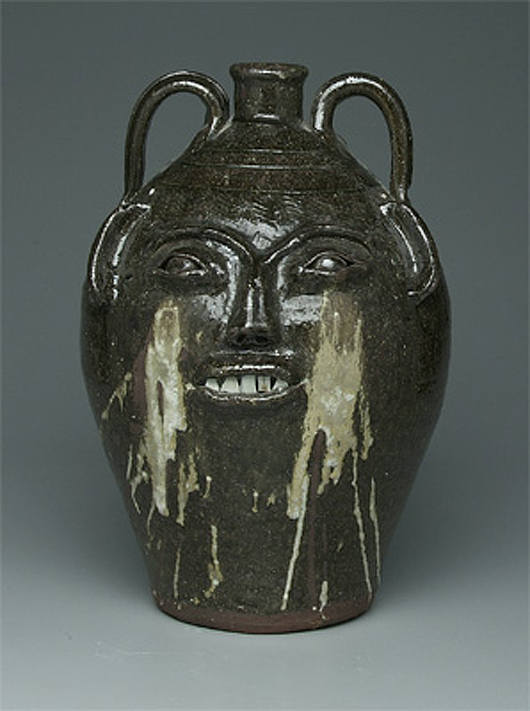 """Collectors prize the """"weepy"""" eyes on face jugs signed by potter Burlon Craig (1914-2002) who worked Vale, Catawba County, N.C. Brunk Auctions in Asheville, N.C., sold this 19-inch piece for $5,200 in 2007. Courtesy Brunk Auction."""