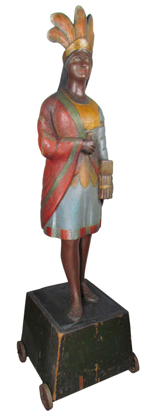 Circa 1880s wooden cigar store Indian, 83 inches tall, possibly carved by Thomas Brooks (est. $50,000-$75,000). Showtime Auctions image.