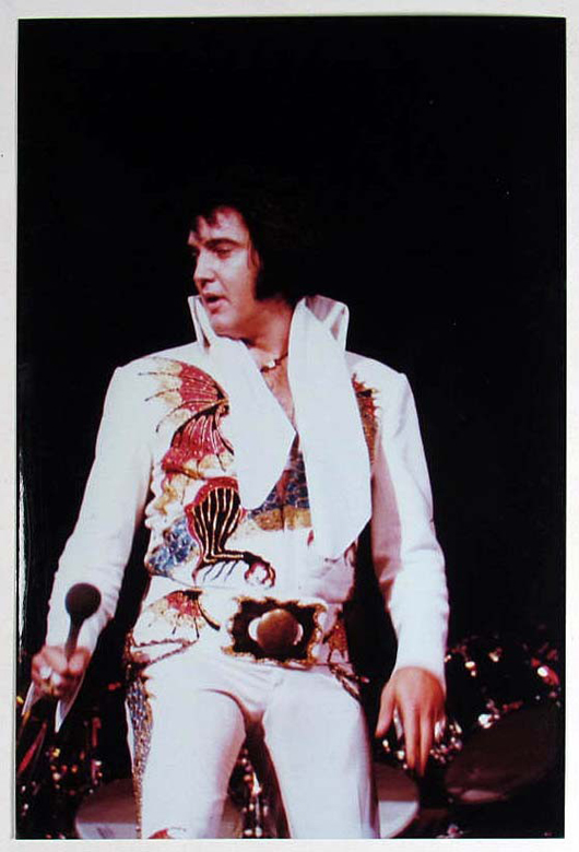 Elvis Presley at a live performance. Image courtesy of LiveAuctioneers.com Archive and Pioneer Auction Gallery.