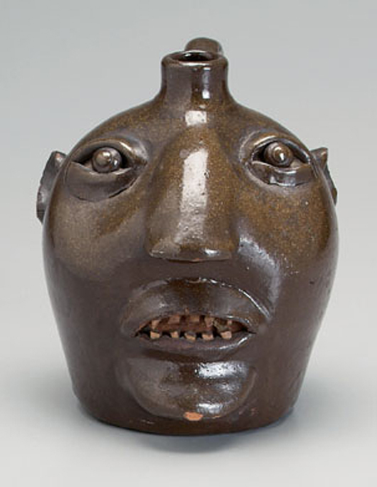 W.T.B. Gordy (1877-1955) of Greenville, Ga., made this sculptural face jug covered in smooth brown Albany glaze around 1900. In the 2009 Brunk auction of the Griffin Collection the lot, which came with an excellent provenance, sold for $8,200 (est. $2,000-$4,000). Courtesy Brunk Auction.