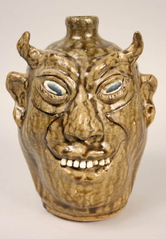 The devil face jug became best-selling variation on the form. This example, covered in an olive green alkaline glaze and signed by Georgia potter Lanier Meaders (1917-1998), sold for $2,000 at Case Auction in 2009. Courtesy Case Auctions.