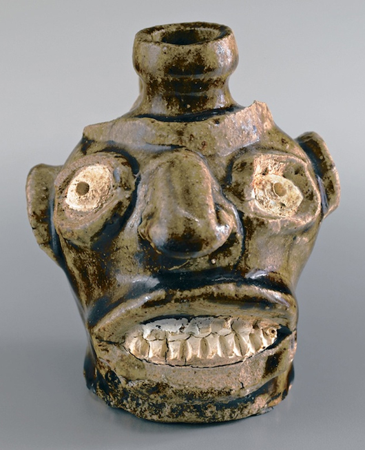 Unlike the more polished products of 20th century potters, early face jugs are often roughly modeled with exaggerated features. This example – only 4 1/4 inches high – is on view in the traveling face jugs exhibition. Private Collection.