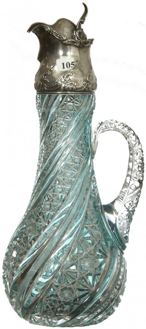 This 16-inch turquoise cut to clear claret jug attributed to J. Hoare, with embossed Gorham sterling spout sold for $75,000. Woody Auction image.