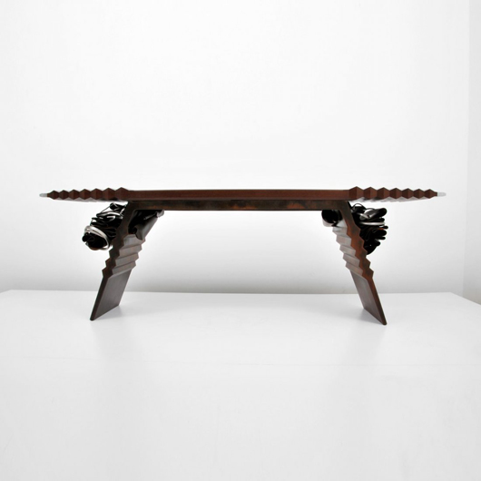 Premier contemporary designers led the charge in combining disparate elements and styles. This Albert Paley (American, b. 1944-) console/sofa table is made of forged and fabricated steel and wood, with eccentrically pleated and mashed metal adornments. It is expected to make $25,000-$45,000 at Palm Beach Modern's March 30 auction. Palm Beach Modern Auctions image.