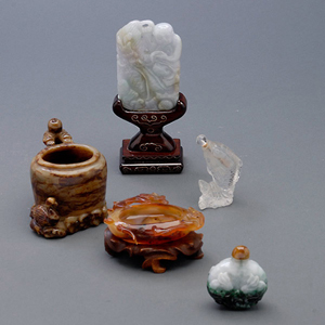 Group of five Chinese decorations including two washers, a jade plaque of boy and dragon, and two snuff bottles. Estimate: $400-$600. Michaan's Auction image.