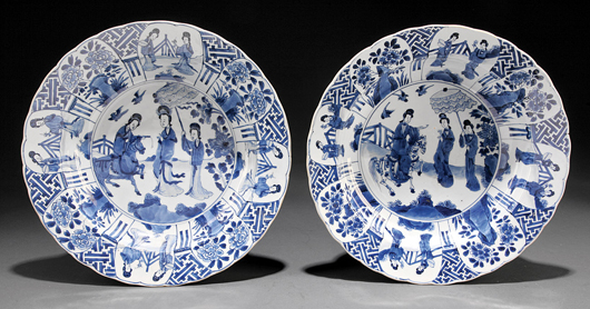 In April 2012, this near pair of blue and white bowls sold at Neal's for $8,365 (estimate: $1,500/$2,500). The dishes with their center and border paintings of court ladies bore Kangxi marks which would date them 1662-1722. Courtesy Neal Auction Co., New Orleans.