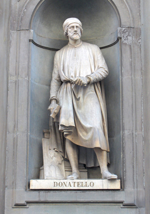 A statue of sculptor Donatello outside of the Uffizi Gallery, a museum in Florence. Image courtesy of Wikimedia Commons.