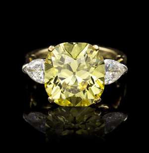 Fancy vivid yellow color diamond ring, 7.85 carats. Price realized $542,500. Leslie Hindman Auctioneers image.