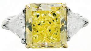 Lovely Cartier-certified 6.01-carat fancy intense yellow diamond ring. Estimate: $100,000-$200,000. A.B. Levy's image.