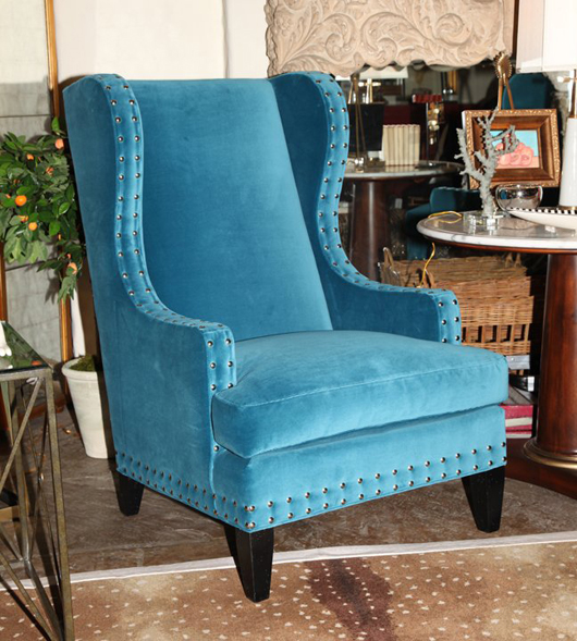Clayton Chair by Lillian August for Hickory White. It has an Umbria finish and Martin Blue fabric. Overall dimensions: W 32 inches, D 38 inches, H 47 inches. Estimate: $2,065-$2,585. Adamsleigh ShowHouse image.