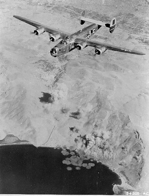 B-24 of the 464th Bomb Group on a bomb run. Image courtesy of Wikimedia Commons.