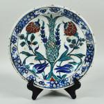 Iznik pottery charger. Woodbury Auction image.