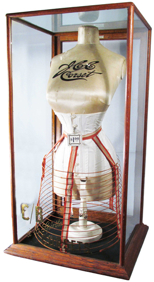 C/B a la Spirite corset display having original etched and gold leaf in front of display case, with mannequin, sold for $17,100. Showtime Auction Services image.