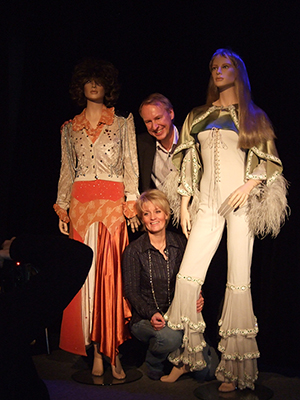 Ewa Wigenheim-Westman and Ulf Westman, founders of ABBA the Museum, with costumes worn by the 1970s group. Image by Song bird 3. This file is licensed under the Creative Commons Attribution-Share Alike 3.0 Unported license.