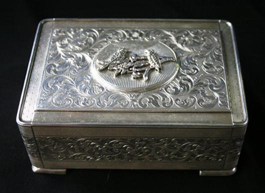 Circa-1920 Jaeger Le Coultre gem-set silver gilt box with singing bird automaton. Est. $10,000-$15,000. Ravenswick image.
