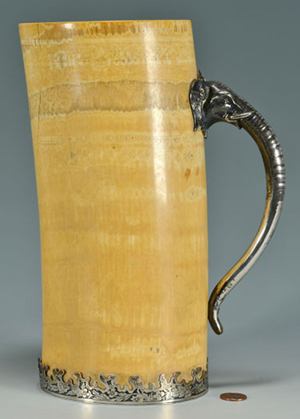 This late 19th century elephant tusk with Gorham sterling silver mounts, including an elephant head handle, measures over 10 inches tall and is estimated at $5,000-7,000. Case Antiques image.