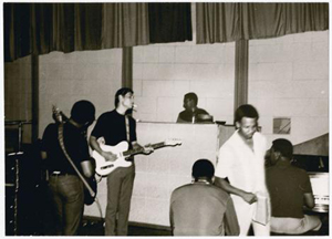 Among the rare Studio A photographs in the Jonas Bernholm exhibit currently on view at the Stax Museum of American Soul Music is this one that includes several legendary Memphis musicians: James Alexander (shown from behind) on bass, Steve Cropper on guitar, Al Jackson Jr on drums, then-unknown singer/songwriter Eddie Floyd (standing) and Booker T Jones on keyboard. Photo courtesy of Stax Museum of American Soul Music.
