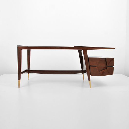 Gio Ponti (Italian, 1891-1979) important walnut and brass desk with asymmetrical cutout drawers, regarded by Ponti to be his 'masterpiece.' Estimate $50,000-$70,000. Palm Beach Modern Auctions image.