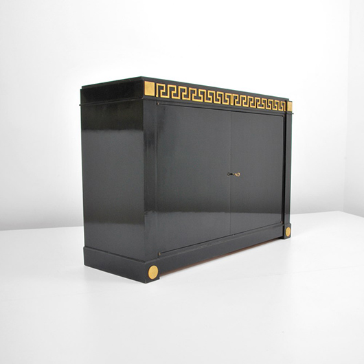 Andre Arbus (French, 1903-1969) ebonized wood, bronze and marble cabinet with Greek-key design, circa 1950, ex Christie's London. Estimate $20,000-$30,000. Palm Beach Modern Auctions image.