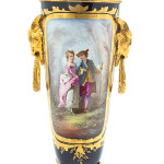 A courting couple is pictured on this Sevres-style porcelain urn. It has gilt metal mounts and a lid. The 17-1/2-inch urn sold for $1,750 at a 2013 Leslie Hindman auction in Chicago.