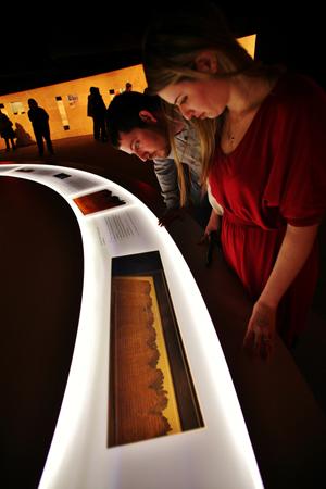 Visitors explore the Dead Sea Scrolls exhibit at the Franklin Institute in Philadelphia in May 2012. Photo credit: Darryl Moran/The Franklin Institute.