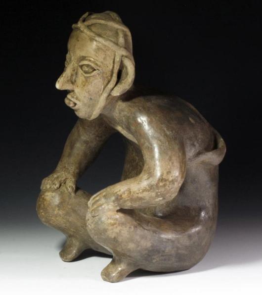 Olmec standing hunchback figure, est. $16,000-$20,000. Antiquities Saleroom image.