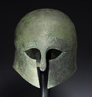 Greek Corinthian bronze helmet, est. $30,000-$45,000. Antiquities Saleroom image.