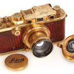 1931 Leica III 'Luxus' camera, gold plated and trimmed in brown lizard leather, with two lenses. Price realized: $683,000. Image courtesy of Westlicht Photographica Auction.