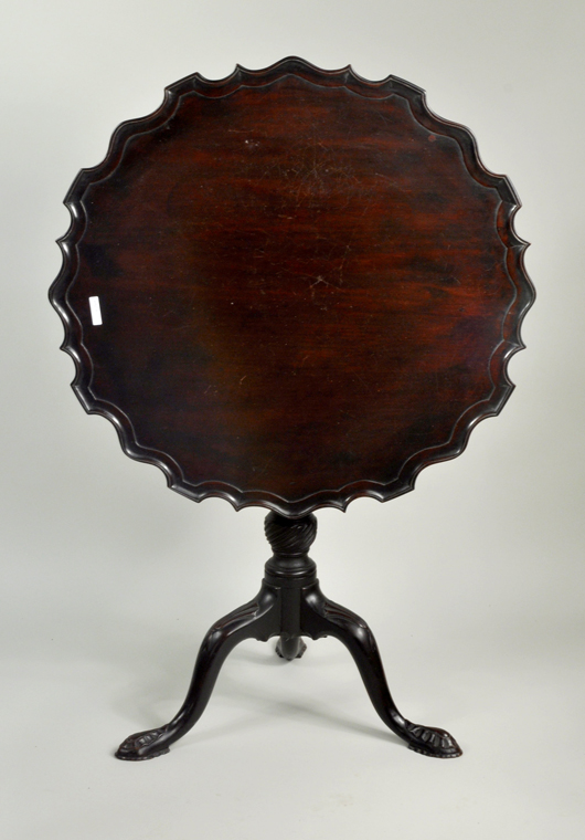George III mahogany piecrust table. Woodbury Auction image.