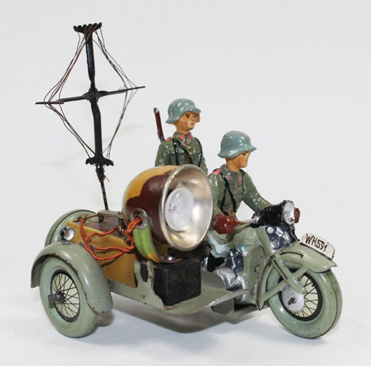 Elastolin Signal Corps motorcycle. Old Toy Soldier Auctions image.