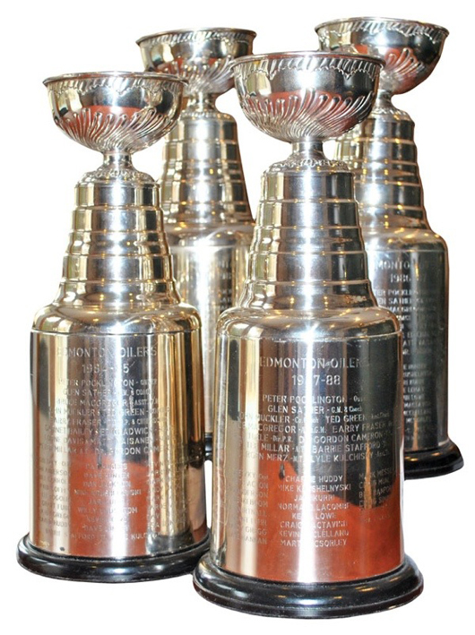 Collection of four Stanley Cup Trophies awarded to Kevin McClelland of the Edmonton Oilers (1984, 1985, 1987, 1988), $32,545. Grey Flannel Auctions image.