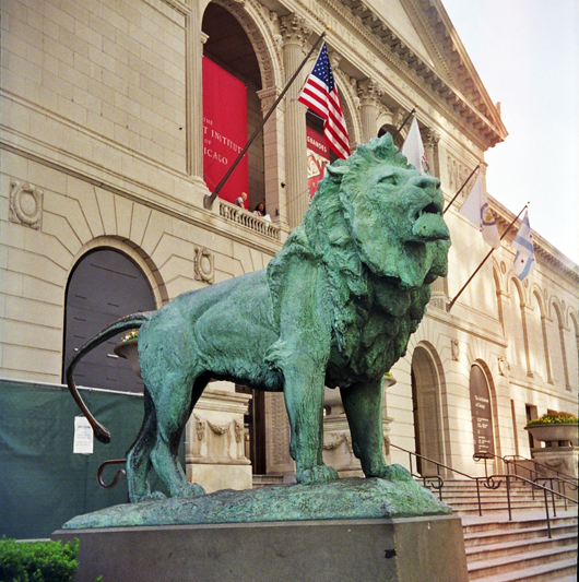 One of a pair of lion sculptures by Edward Kemeys that guard the entrance to the Art Institute of Chicago. Photo by Kim Scarborough, licensed under the Creative Commons Attribution-Share Alike 3.0 United States license.