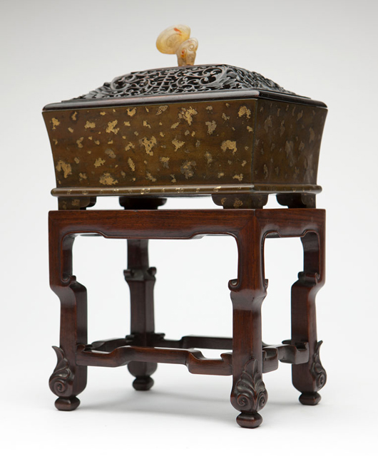 One of the select group of Asian works of art in Moran's sale is this gilt-splashed Chinese bronze censer dating to the 17th or 18th century (estimate: $3,000-$5,000). John Moran Auctioneers image.
