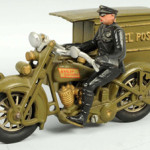 Hubley cast-iron Parcel Post motorcycle toy with original back door and rider, 9½in, est. $2,000-$4,000. Morphy Auctions image.