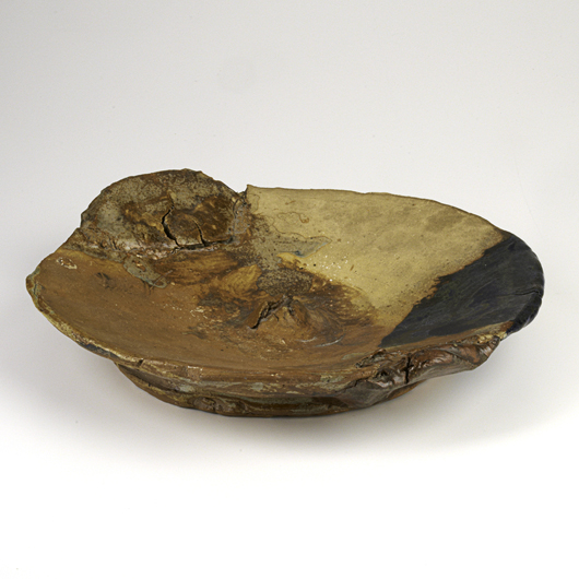 This early glazed stoneware platter – 'D. 14' – was signed and dated 1962. The volcanic energy of the work helped the lot realize $11,250 at a Rago Auction in February 2012. Courtesy Rago Auctions