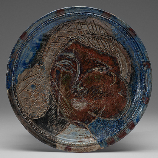 A rare early work by Voulkos, this portrait charger incised with portrait of a woman was made around 1952 at the Archie Bray Foundation in Helena, Montana; the stoneware plate brought $3,000 at Cowan's in May. Courtesy Cowan's+Clark+Delvecchio Auctions