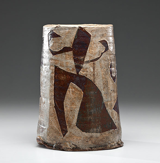 In the mid-1950s, Voulkos experimented with using stencils to created raised abstract figural designs in the glaze of his pots. This signed 1957 vase, which had been exhibited at the potter's 1995 retrospective in Japan, sold for $24,000 at Cowan's in May. Courtesy Cowan's+Clark+Delvecchio Auctions