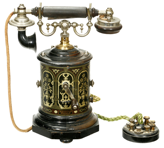An 1895 L.M. Ericsson desk telephone known as the 'Coffee Grinder' for its distinctive circular shape and colorful lithography, sold for 14,756 euros (US $19,200). Auction Team Breker image.