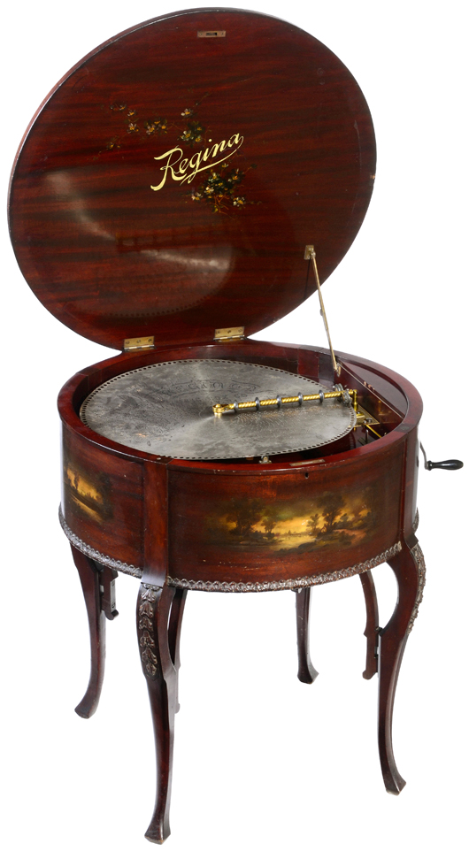 This elegant 'drum-table' disc musical box decorated in the style of Rookwood pottery by the Regina company of New Jersey sold for 11,388 euros (US $14,800). Auction Team Breker image.