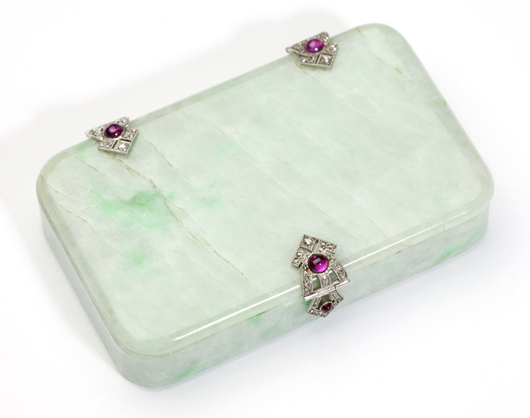 Set with ruby cabochons and platinum hardware, this French jade compact found a buyer at $7,800 (estimate: $1,000 to $1,500). John Moran Auctioneers image.