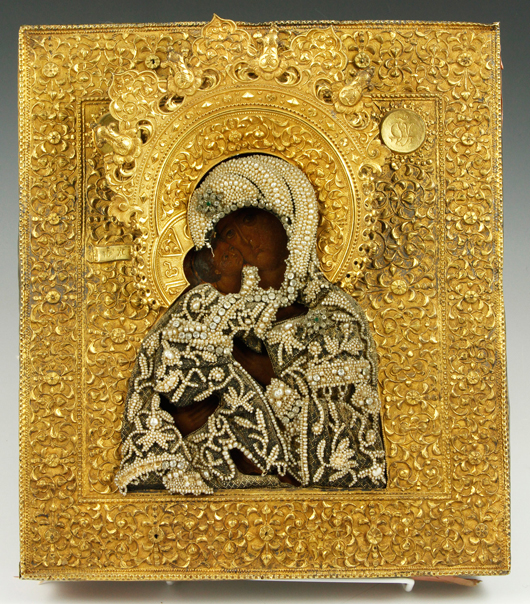 18th century, Russian icon of the Kazan Mother of God, gilded silver oklad chased with foliage, jeweled shroud of natural pearls and jewels, tests silver, approximately 16.95 troy oz tw, 12 1/2 inches h x 11 inches w. Provenance: This Icon was presented to Peter Denisevich by the Moscow Military Attache in 1946.